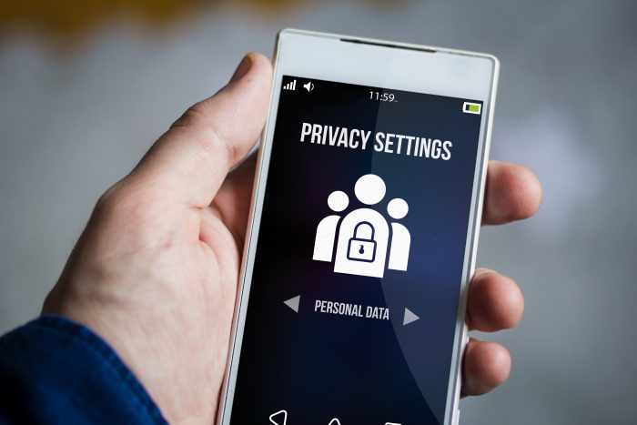 holding privacy settings smartphone